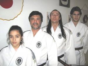 Cinthya Almada y Boris Morán Elordieta con los entrenadores Jorge Juri y Ariel Alvarez.