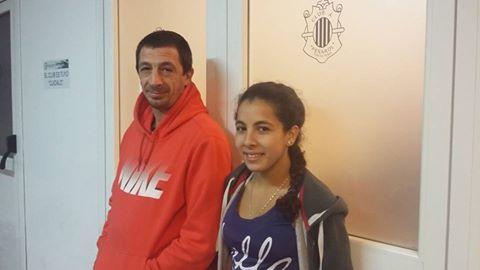 El  entrenador Pedro Cambiaso y la joven Luchadora Milagros Ortiz.
